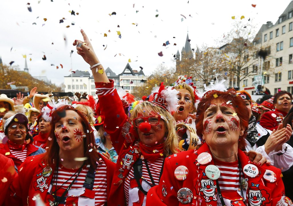 Carnival revellers celebrate the start of the carnival season in Cologne